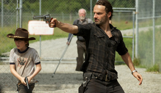 Carl Grimes (Chandler Riggs) and Rick Grimes (Andrew Lincoln) - (Background) Hershel Greene (Scott Wilson) - The Walking Dead - Season 3, Episode 7 - Photo Credit: Blake Tyers/AMC